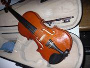 Geige mit Tasche und Bogen