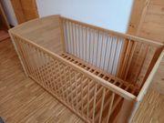 Babybett mit Gitter aus Massivholz