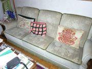 Couch mit drei Sessel