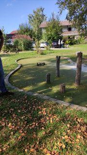 Gartenarbeit als Nebenbeschäftigung in Murnau