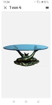 Glastisch mit Delfine
