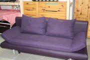 Schlafcouch in violett mit Federkern