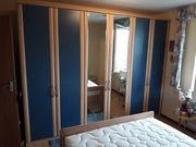 Nolte Kleiderschrank blau und helles