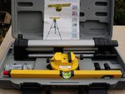 Laserwasserwaage im Koffer mit Nivelierteller