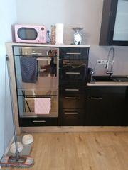 L Form Küche in schwarz