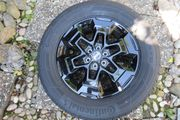 4 schwarze Alu-Felgen m Reifen