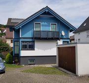 Holzhaus mit großzügiger 3 Zi-Wohnung