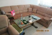 Wohnzimmersitzecke und Sessel braun