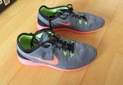 NEUE graue Laufschuhe Damen Nike