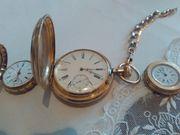 drei goldene Uhren
