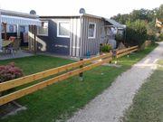 Wohnwagen mit ausgebautem Vorbau in