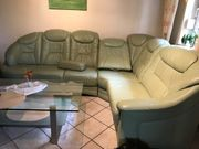 Ledereckcouch mit Sessel und Hocker