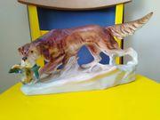 ROYAL DUX Jagdhund apportiert Fasan