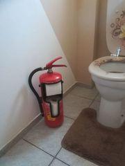 Feuerlöscher WC Papier Halter