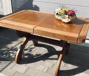 Massiver ausziehbarer Holztisch