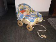 Kinder Puppe mit Puppenwagen zum