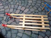 Kinderschlitten aus Holz