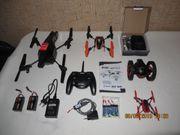 Diverse Drohnen mit viel Zubehör