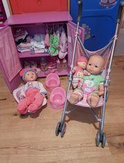 2 Puppen Puppenschrank Puppenbuggy Puppenkleider