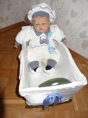 Reborn-Baby mit Wiege