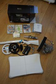 Wii mit 4 Spielen zu