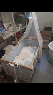 Babybett mit Wiegefunktion
