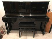 Klavier der Marke Feurich Modell