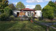 Dauercampingplatz mit zwei Wohnwagen bei