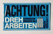 Reklameschild Schwarzer Krauser
