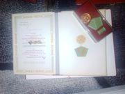 Ehrenmedallien der DDR mit Urkunde