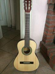 Voggy s Kindergitarre 3 4