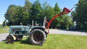 Traktor mit Hecklader