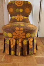 Retro-Sessel mit Stoffbezug aus den
