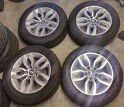 Originale BMW-Alufelgen gute Dunlop-Winterreifen RDKS