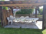 2 Gartentische und 10 Stühle