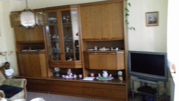 Wohnwand Tisch Sideboard und Uhr