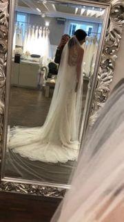 Hochzeitskleid mit Schleier zu verkaufen