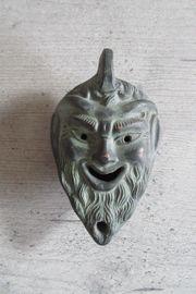 Römische Öllampe mit Gesicht