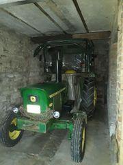 John Deere Traktor mit Seilwinde