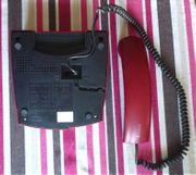 rotes Telefon zum telefonieren