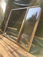Doppelflügelige Terrassentür aus Aluminium zu