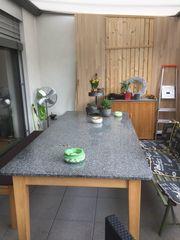 Esszimmer oder Gartentisch mit Steinplatte