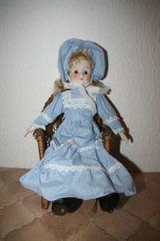 Puppe mit Prozellangesicht