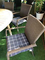 4 Rattan Stühle mit Armlehnen