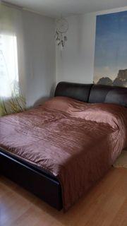 Braunes Polsterbett Bett
