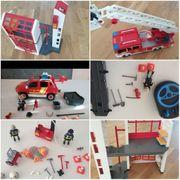 Lego Polizeiquartier und Playmobil Feuerwehrhaus