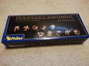 Knobelpuzzle aus Holz Spiel