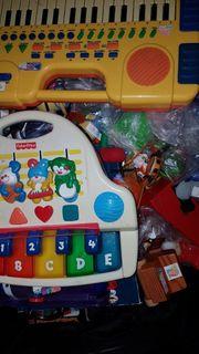 1 Trolley voll mit Kinderflohmarktsachen