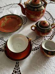 Teeservice mit goldenem Drachen