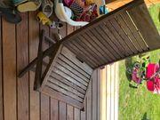 4 Teak Holz Stühle und